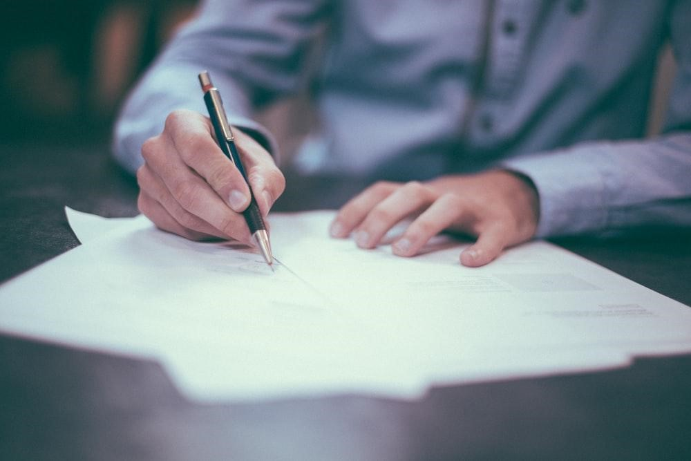 Man planning legal papers for his business